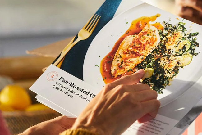Plated women hand on recipe flayer