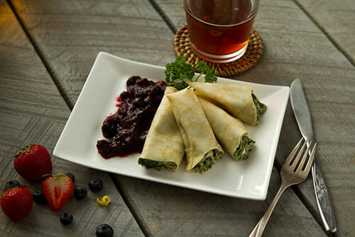spinach-mushroom-crepe with mixed berry compote