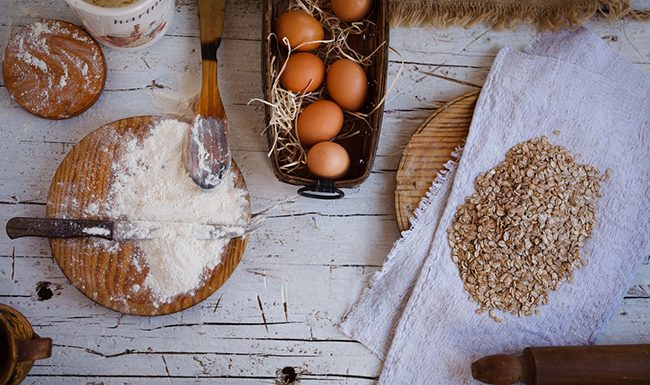 Baking ingredients in the kitchen with a bowl of eggs, free gluten flour