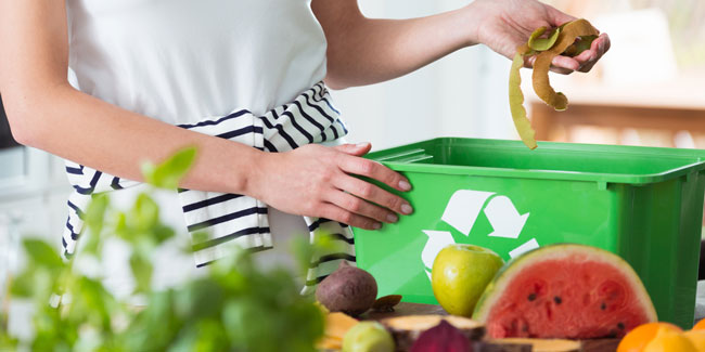 Woman and recycling organic kitchen waste