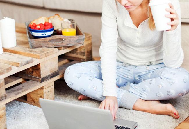 Doordash women order meals over laptop computer